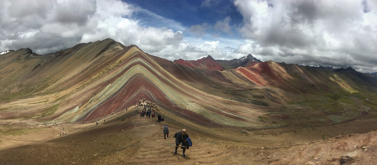People walking towards Rainbow Mountain Peru viewpoint